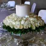 Silver bowl and roses and pillar candle