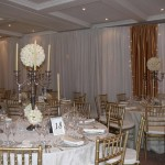 White Draping with Gold Runners and Lights